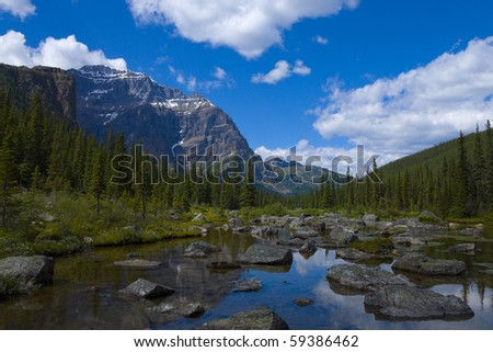 "At the end of a hiking trail you'll find ""Consolation Lake"" in Banff National Park, Alberta, Canada - stock photo"