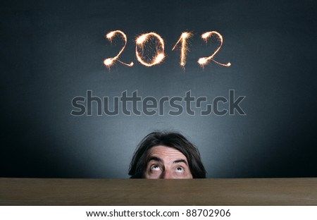 At the 2012 figures of Bengal fire watching a man's face. - stock photo