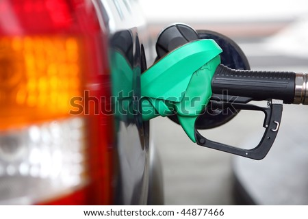 At the gas pump - stock photo