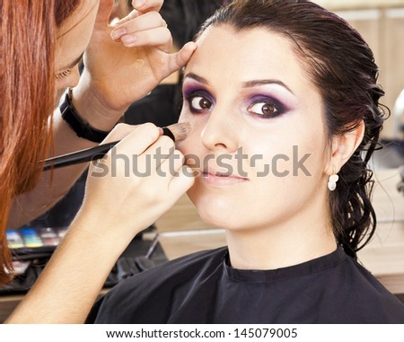 At the hairdresser woman gets new hair color - stock photo