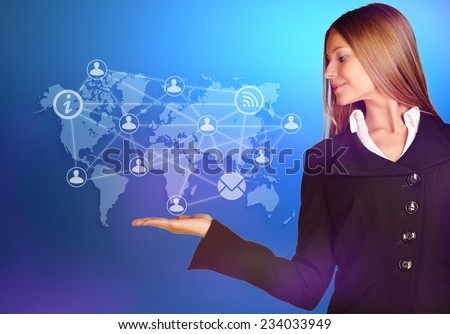 at the hand of business woman over a world map with icons people