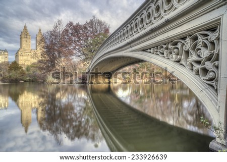 At the Lake in Central Park in autumn at bow bridge - stock photo