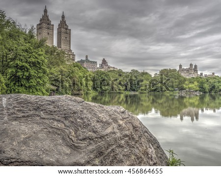 At the Lake in Central Park in summer with clouds - stock photo