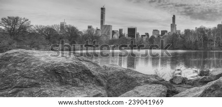 At the Lake late in the afternoon by rocks - stock photo
