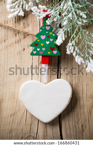 At the wooden board with pegs pinned Christmas ornament.