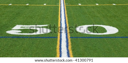 At the 50 yard line on a football field - stock photo