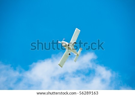 AT-3 type airplane flying through sky with clouds - stock photo