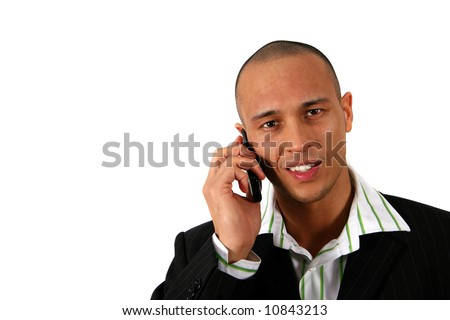 At Work Stylish young man in suit is using his cell phone. Isolated over white. - stock photo