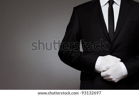 At Your service. Waiter, or well dressed man waiting for orders with copy space - stock photo