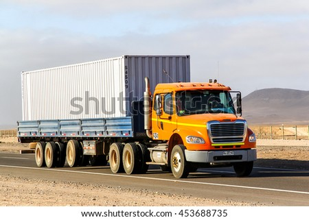 ATACAMA, CHILE - NOVEMBER 18, 2015: Semi-trailer truck Freightliner Business Class at the Pan-American Highway through the Atacama desert. - stock photo
