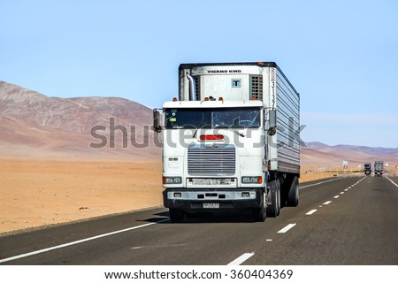 ATACAMA, CHILE - NOVEMBER 14, 2015: Semi-trailer truck Freightliner FLB at the interurban freeway. - stock photo