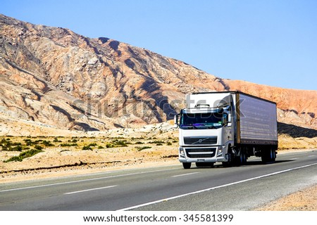 ATACAMA, CHILE - NOVEMBER 14, 2015: Semi-trailer truck Volvo FH12 at the interurban freeway. - stock photo