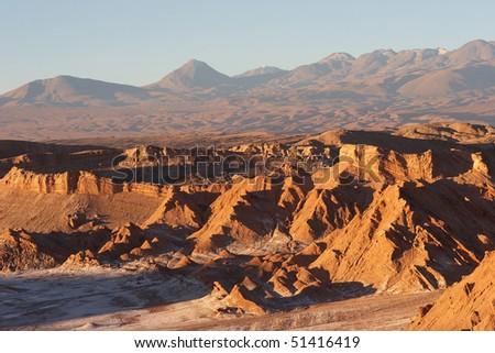 Atacama Desert and volcano range in evening, Chile - stock photo