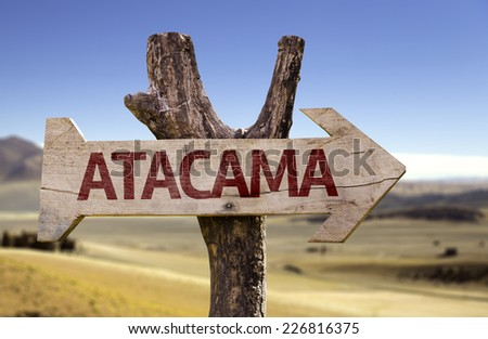 Atacama wooden sign with a desert background - stock photo
