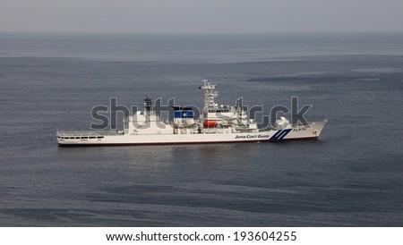 ATAMI, JAPAN - MAY 19, 2014: A Japan Coast Guard ship anchored in Atami Bay, Shizouka Prefecture, Japan. The Japan Coast Guard is responsible for the protection of the coast-lines of Japan. - stock photo
