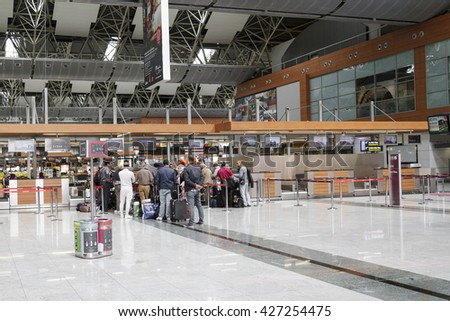 Ataturk airport , Istanbul,Turkey , April 19,2016, pPeople waiting in line to make check-in for their flight and drop-off their luggage. - stock photo