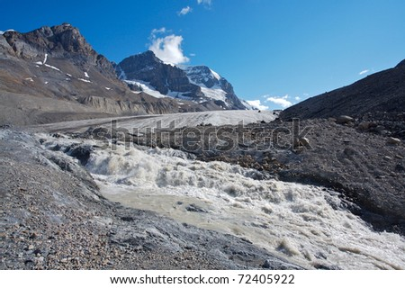 Athabasca glacier with melt water, Mount Andromeda in the background