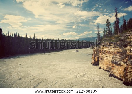 Athabasca River in the evening. Jasper National Park, Alberta, Canada.  - stock photo