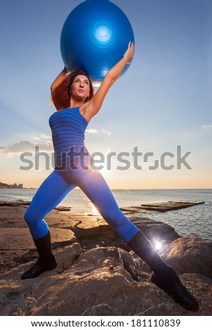 Atheletic girl and ball