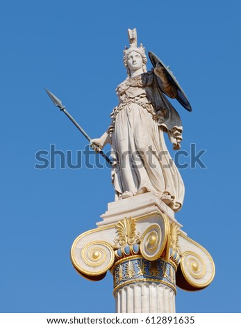 Athena statue on blue sky background, ancient greek goddess of knowledge and wisdom