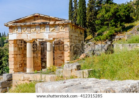 Athenian Treasury in Delphi, an archaeological site in Greece, at the Mount Parnassus. Delphi is famous by the oracle at the sanctuary dedicated to Apollo. UNESCO World heritage - stock photo