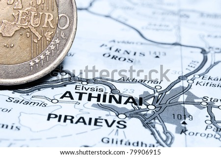Athens and Euro coin Concept studio shot depicting current economic issues surrounding the Greek economy and the Euro - stock photo
