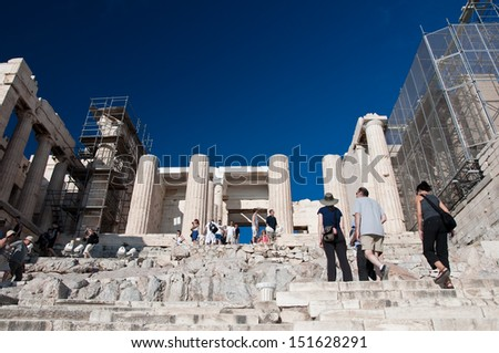 ATHENS - AUGUST 01: Acropolis of Athens on July 1, 2013 in Greece. The Acropolis of Athens is an ancient citadel located on a high rocky outcrop above the city of Athens