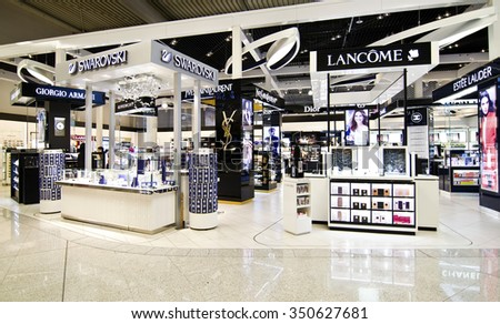 ATHENS GREECE AIRPORT, DECEMBER 13 2015: duty free shops at Eleftherios Venizelos airport in Athens Greece, swarovski, lancome, dior shops, Editorial use - stock photo