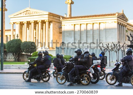 ATHENS, GREECE - APR 16, 2015: Riot police on motorcycles during a rally in front of the Athens University, which is under occupation by the protesters and leftist anarchist groups. - stock photo