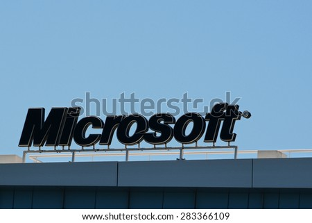 ATHENS, GREECE - APRIL 17, 2015: Microsoft office building detail of sign with logo against blue sky. - stock photo