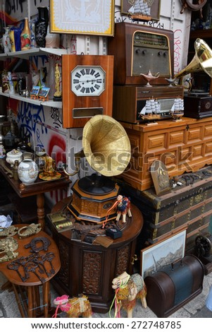 ATHENS, GREECE - APRIL 24, 2015: Vintage objects and furniture for sale at street market antiques shop. - stock photo