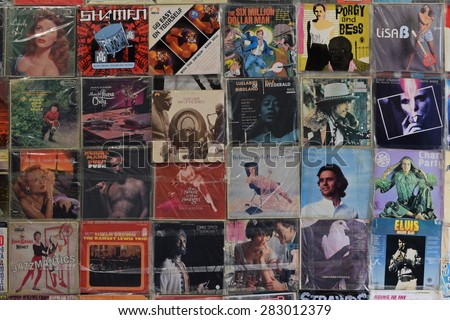 ATHENS, GREECE - APRIL 24, 2015: Wall with old vinyl records vintage music lp album covers in plastic sleeves background.