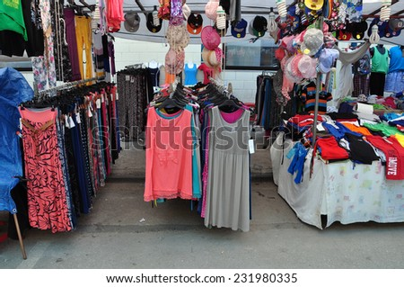ATHENS, GREECE - AUGUST 15, 2014: Casual summer clothes and accessories for sale at street market. - stock photo