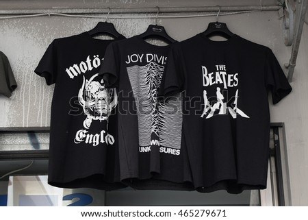 ATHENS, GREECE - AUGUST 4, 2016: Rock music t-shirts printed with band logos for sale. The Beatles, Joy Division and Motorhead designs.