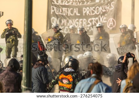 ATHENS, GREECE - CIRCA APR, 2015: Anarchist protest near Athens University, which has been occupied by protesters - voiced support for a hunger strike by prisoners convicted under anti-terrorism laws. - stock photo