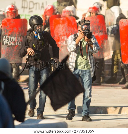 ATHENS, GREECE - CIRCA APR, 2015: Unknown photographers. Anarchist groups seeking abolition of new maximum security prisons, clashed with riot police, who responded with tear gas and stun grenades. - stock photo
