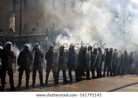 ATHENS, GREECE -DEC. 12, 2008: Greek riot police officers protect the Parliament from demonstrators in Athens, Greece, Dec. 12, 2008. - stock photo