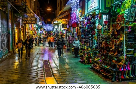 ATHENS, GREECE, DECEMBER 10, 2015: Night view of a shopping street near monastiraki square - one of the most important tourist street in the historical district of athens called plaka
