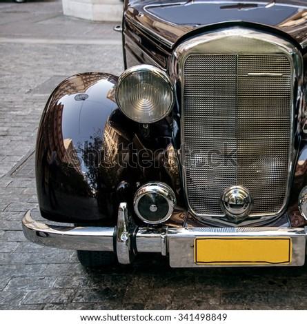 Athens, Greece - December 8, 2015: Old bumper and headlights retro  black car  on the street - stock photo