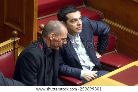ATHENS, GREECE - FEBRUARY 18,2015: Prime Minister Alexis Tsipras (R) talks with Finance Minister Yanis Varoufakis (L) at the Parliament during the voting session for President of Greece - stock photo