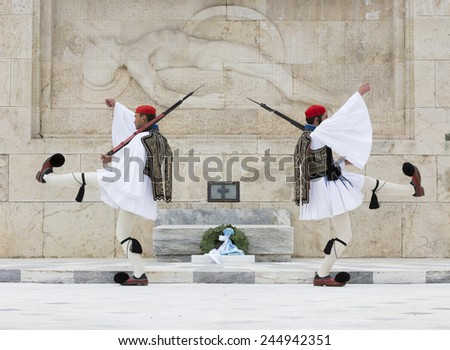 ATHENS,GREECE - JAN 11 :The Euzones - historical elite unit of the Greek Army that guards the Greek Tomb of the Unknown Soldier and the Presidential Mansion,January  11, 2015 in Athens,Greece - stock photo