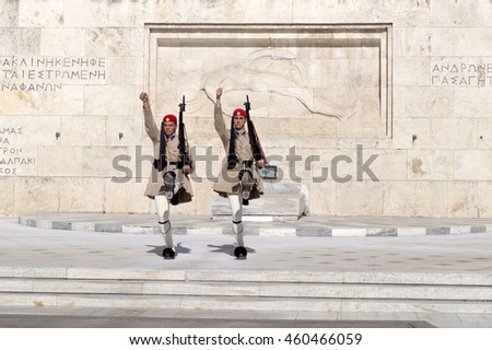 Athens, Greece - JULY 18, 2016: Evzone guarding the Tomb of Unknown Soldier in Athens dressed in service uniform, refers to the members of the Presidential Guard, an elite ceremonial unit.