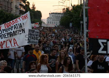 Athens, Greece July 22 2014: March of solidarity with the Palestinian people and free Gaza.  4-5 thousands of demonstrators took part in a rally to protest civilian deaths from Israeli  bombs in Gaza  - stock photo