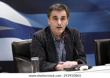 ATHENS, GREECE - JULY 6, 2015: New Greek Finance Minister Euclid Tsakalotos during for a hand over ceremony - stock photo