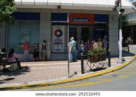 ATHENS, GREECE - JULY 1, 2015: People patiently waiting at ATM cashpoint queue. Banks are closed and capital controls implemented allow a daily cash money withdrawal of 60 euro. Greek debt crisis. - stock photo