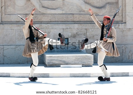 "ATHENS, GREECE - JULY 9: Traditional ""Changing of the Guard"" Ceremony at the Greek Parliament building near Syntagma Square, July 9, 2011. - stock photo"