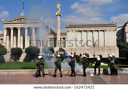 ATHENS, GREECE - MARCH 03. Riot police during clashes, in front of the Academy of Athens, March 03,2010. - stock photo