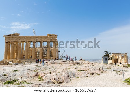 ATHENS, GREECE - MARCH 27 , 2014 : Tourists in famous old city Acropolis Parthenon Temple. Its construction began in 447 BC in the Athenian Empire. It was completed in 438 BC