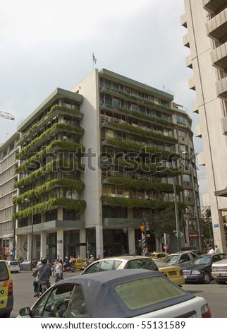 ATHENS, GREECE - MAY 18: Ecological and luxurious apartment building with typical balconies for a green environment , Athens, Greece, 18 May 2007 - stock photo