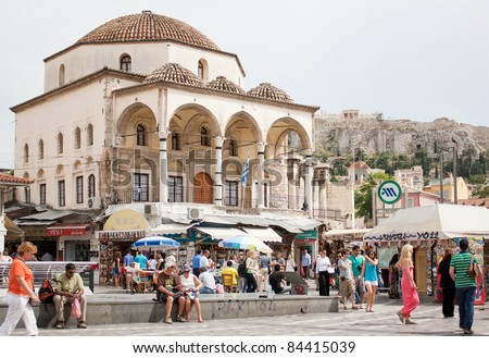 ATHENS, GREECE - MAY 24: Greece on the verge of bankruptcy. Tourism is a decisive sector of hope for Greek economy. Athenians and tourists in Monastiraki Square, May 24, 2011 in Athens, Greece. - stock photo